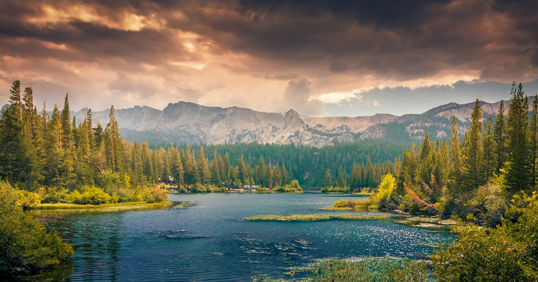 landscape of lake, mountains and clouds